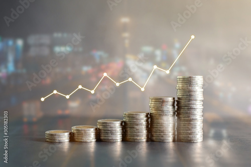 Fototapeta Double exposure stack of Thailand coins on black wooden table with profit graph, growth up, success on blur background of night road. Business, finance, marketing, e-commerce concept and design obraz