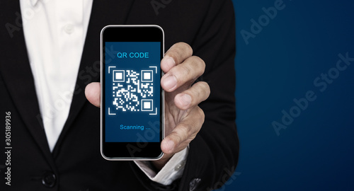 Valokuva  QR code scanning payment and verification