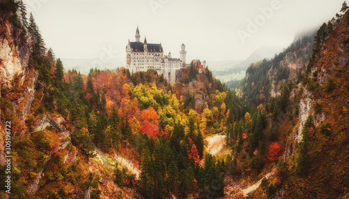 Foto auf Leinwand Dunkelbraun Amazing panoramiс view of Neuschwanstein castle in autumn season. Fussen. Bavaria, Germany. Neuschwanstein castle one of the most popular palace and travel destinations in Europe and the world.