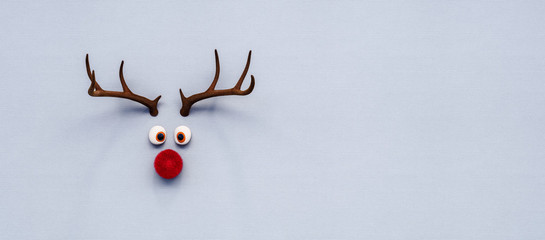 Reindeer toy with red nose Christmas background concept 3D Rendering