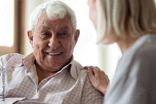 Papel de parede  Smiling elder male patient communicating with nurse.