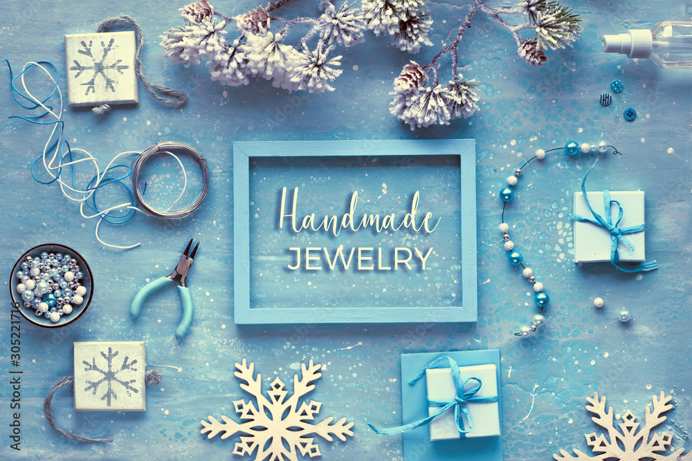 Fototapeta Making handmade jewelry for friends as Winter holiday gifts. Flat lay on dark textured background, text