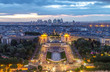 Aerial panoramic view of Paris from Eiffel Tower in the direction of Trocadero and la Defence district. Dusk, blue hour.
