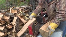 A Man Using A Hydraulic Log Sp...