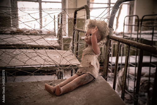 Photo Broken doll in Kopachi kindergarten, Chernobyl alienation zone Ukraine