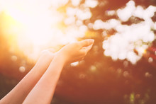 Woman Open Hand Up To Sunset S...