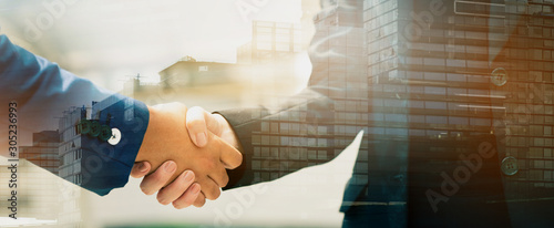 Close up of a business people with a handshake Agreements to do business together show trust and confidence in the investment in real estate Canvas Print