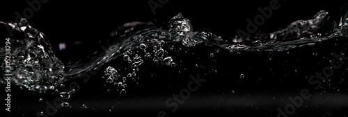 Water splashes on black background.