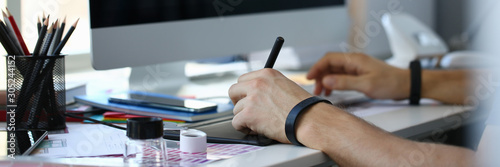 Obraz Designer male arm hold graphic pad pen working on project - fototapety do salonu