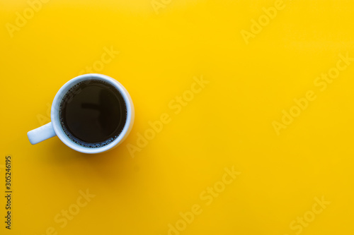 Obraz cup of coffee on yellow background. soft focus. - fototapety do salonu