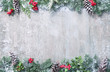 canvas print picture Christmas and New Year background with fir branches and snowfall on wooden white board