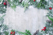 canvas print picture - Christmas and New Year background with fir branches and snowfall on wooden white board