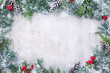 Leinwanddruck Bild - Christmas and New Year background with fir branches and snowfall on wooden white board