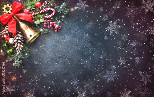 Spoed Foto op Canvas Hoogte schaal Background with Christmas bells, fir tree, pine cones and holiday decoration