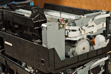 The Printer Is Disassembled Into Parts. Broken, Dirty And Dusty Printer. Service Center For Equipment Repair. Refilling With Ink And Cleaning Of Printing Equipment.
