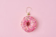 Leinwanddruck Bild - Christmas holiday cretivity concept. Pink donut as a christmas bauble, minimal style