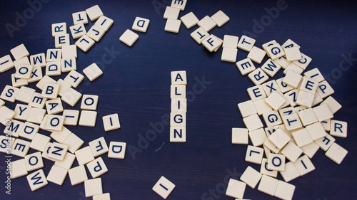 Align tile letters on a black background with mixed letters on either side Wide angle Canvas Print