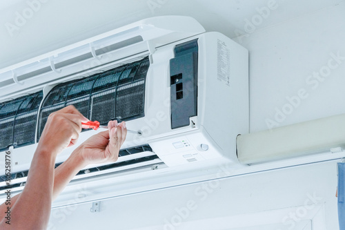 Air conditioner repairing by technician Canvas Print