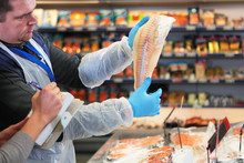 The Fish Department Specialist In The Store Offers Fresh Fish To The Product Expert . Partner Restaurant. Delivery Of Fresh Products From The Hypermarket.