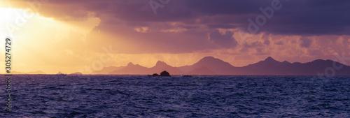 Foto auf Leinwand Aubergine lila Dramatic Sunset Over the Tropical Sea