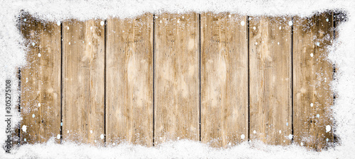 Tuinposter Metal winter Background - Frame made of snow and snowflakes on wooden texture, top view with space for text