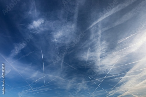 Chemtrails over the blue sky Canvas Print
