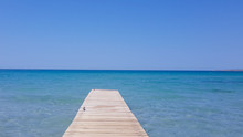 Wooden Pier With Blue Sea And ...