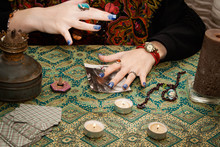 Fortuneteller Looking For A Man Using A Photo