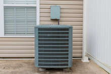 Old Air Conditioning Unit On Condo Patio