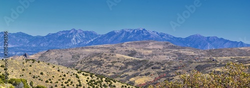 Views of Wasatch Front Rocky Mountains from the Oquirrh Mountains with fall leaves, Hiking in Yellow Fork trail and Rose Canyon in Great Salt Lake Valley. Utah, United States.