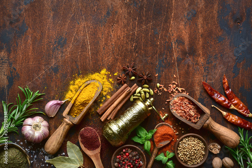 Obraz Assortment of spices and herbs. Top view with copy space. - fototapety do salonu