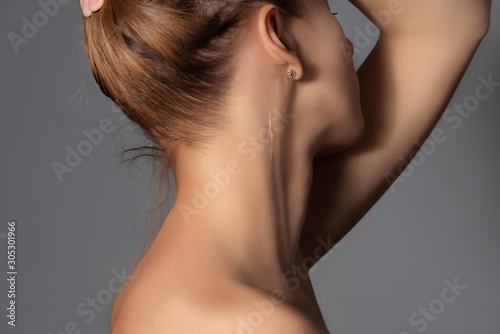 Woman with surgery scar at her neck. Wallpaper Mural