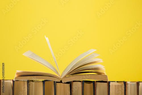 Fotografering  Open book, hardback books on wooden table
