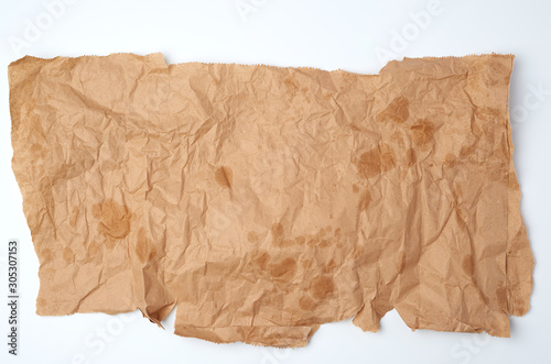 Photo torn crumpled piece of brown paper with grease stains