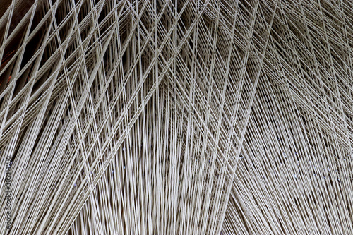 Obraz Close up of a lot of threads in a weaving machine called a loom - fototapety do salonu