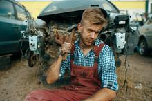 Male Repairman Sitting On The ...