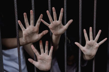 Children In Catch The Iron Prison, Human Trafficking Concept, Human Rights Violations,