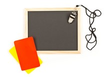 Soccer Sports Referee Yellow And Red Cards With Chrome Whistle On Empty, Blank Blackboard Background With Copy Space