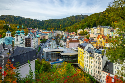 Photo Karlovy Vary with church and hot spring colonnade, Czech Republic