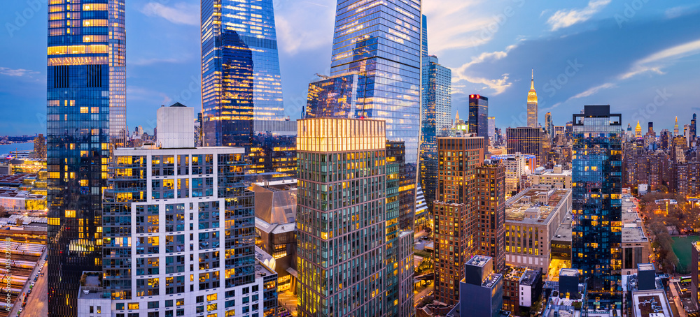 Fototapeta Aerial panorama of New York City skyscrapers at dusk as seen from above the 29th street, close to Hudson Yards and Chelsea neighborhood