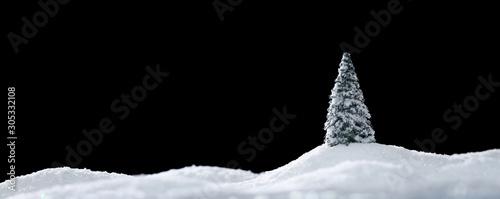 Foto auf Leinwand Schwarz Wintery landscape with single tree on glistening white snow drifts isolated on black
