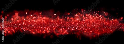 Fototapeta Bokeh of sparkling red lights and glitter on black obraz