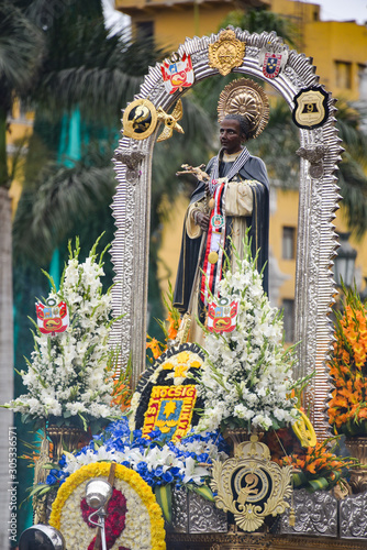 Fototapeta Lima, Peru - Nov 17, 2019: Crowds attend the procession for San Martin de Porres