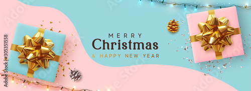 Fototapeta Holiday Christmas Banner. Xmas background with realistic pink and blue gift boxes, festive bright light garland. Horizontal border poster, header for website, greeting card. Advertising flyer brochure obraz na płótnie