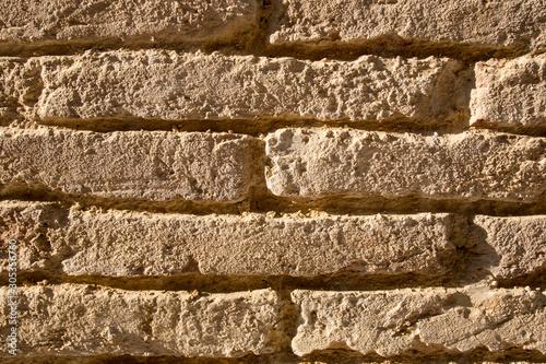 Wall texture of old adobe bricks. Close up Canvas Print