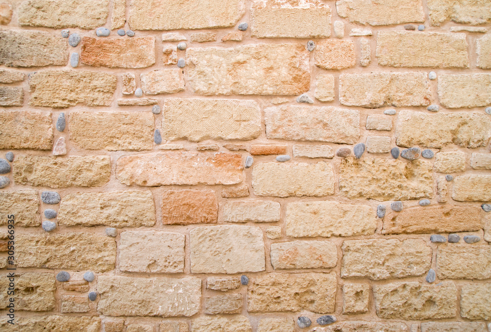Colorful ancient stone wall close up