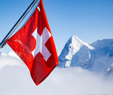 Swiss Flag And Snow Covered Pe...