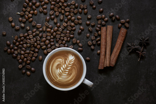 Wall Murals Cafe Latte art coffee and coffee beans on table