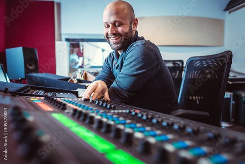 Fotografie, Obraz  Sound engineer mixing a song in his studio