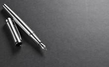 Silver Fountain Pen On A Black...